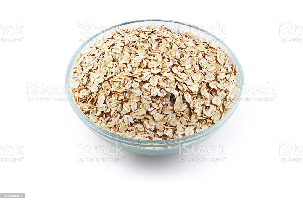 Oats in transparent bowl isolated on white royalty-free stock photo