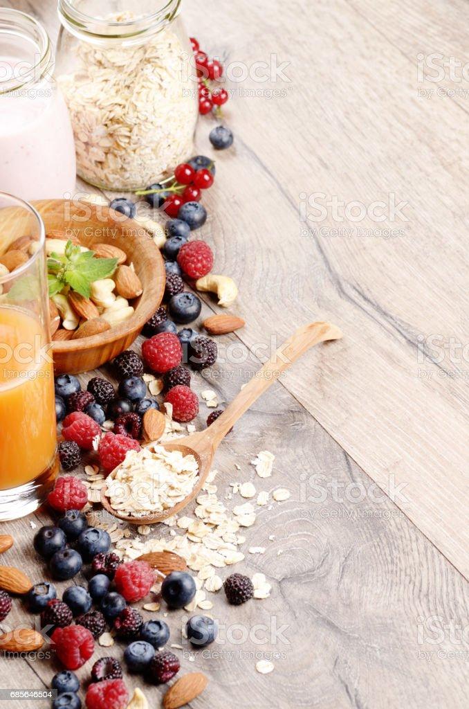 Oats nuts berries yogurt royalty-free stock photo