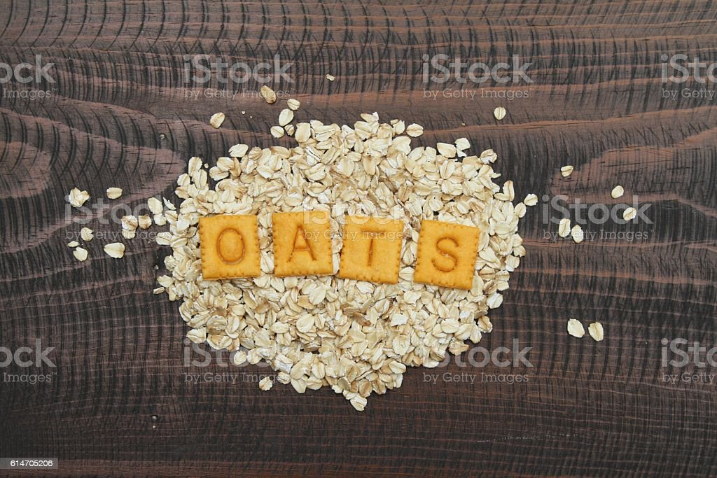 Oats spelled out on pile of oats stock photo