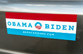 'Gilbert, United States - December 14, 2012: A close up photo of an Obama - Biden bumper sticker. This sticker features the campaign logo and both canidates names.'