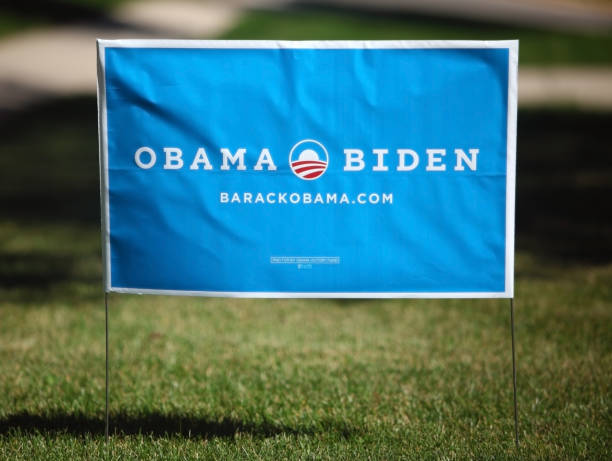 """Obama Presidential Campaign Yard Sign """"Madison, Wisconsin, USA - August 20, 2012: An Obama Biden 2012 presidential campaign yard sign on a green lawn."""" barack obama stock pictures, royalty-free photos & images"""