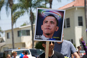 'Long Beach, California, USA - May 20th, 2012: Man holding a sign with the photo of Obama with gay and lesbian decoration during the 2012 Long Beach Lesbian and Gay Pride Parade.'