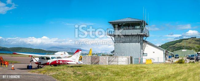 istock Oban / Scotland - May 17 2017: The Oban airport buildings overlooking the airfield 811165626