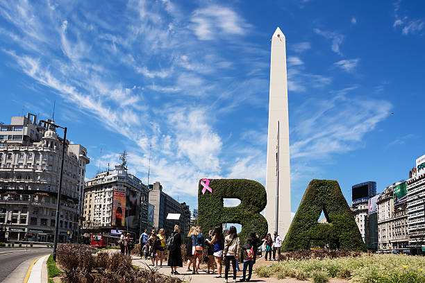 Obelisk and tourist in the center of Buenos Aires stock photo