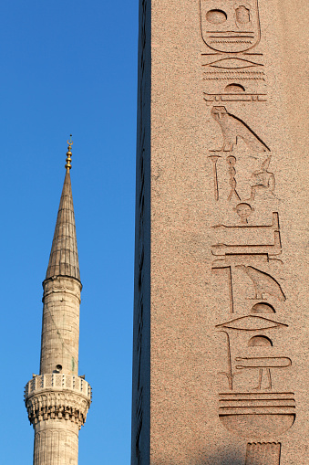 Obelisk of Theodosius Dikilitas with a minaret of Sultanahmet Mosque in Istanbul, Turkey.