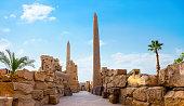 Obelisks and ruins of Karnak temple in Luxor at sunrise, Egypt