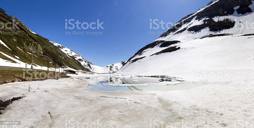 Oberalp pass, Artificial lake ice stock photo