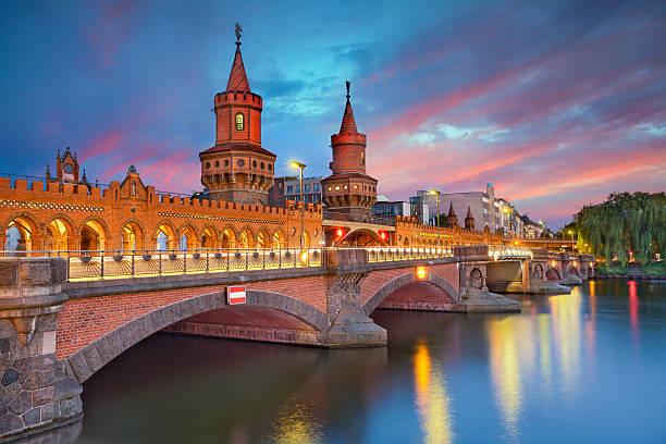Oberbaum Bridge, Berlin. Image of Oberbaum Bridge in Berlin, during dramatic sunset. berlin stock pictures, royalty-free photos & images