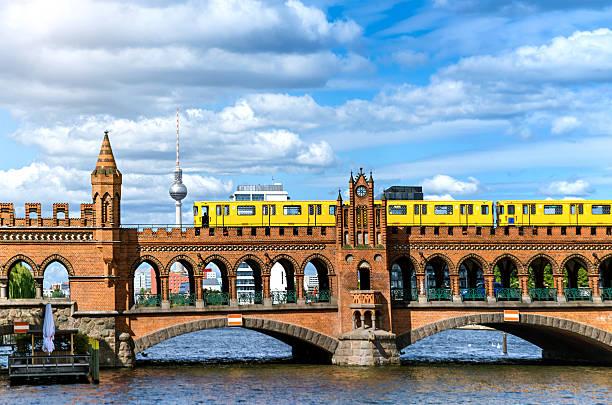 Oberbaum Bridge in Berlin, Germany Landmark Oberbaumbruecke bridge with passing subway train  berlin stock pictures, royalty-free photos & images