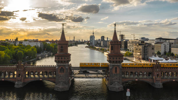 Oberbaum Bridge in Berlin Oberbaum Bridge in Berlin before sunset. Aerial view berlin stock pictures, royalty-free photos & images