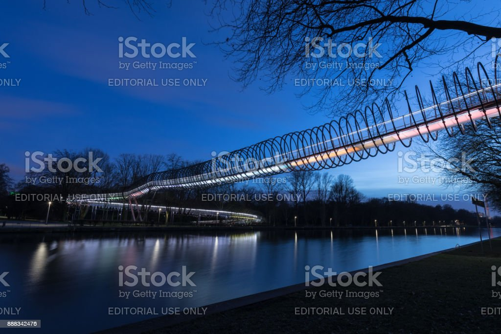 Oberhausen, NRW, Germany - February 21, 2017 At 6.40pm : Illuminated Bridge Slinky Springs To Fame stock photo