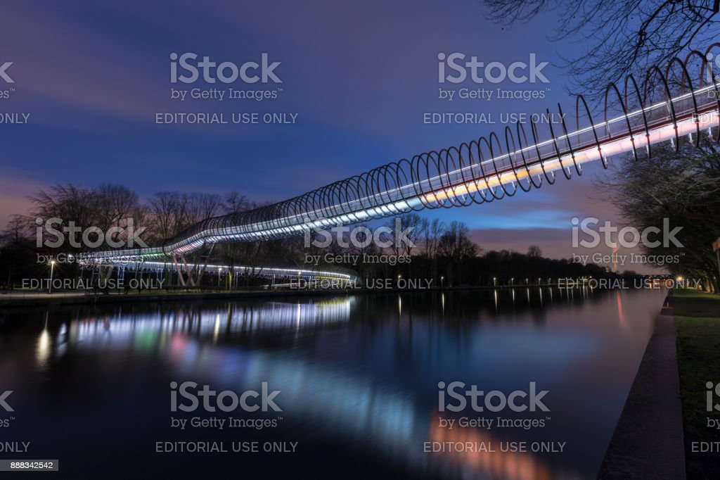 Oberhausen, NRW, Germany - February 21, 2017 At 6.48pm : Illuminated Bridge Slinky Springs To Fame stock photo