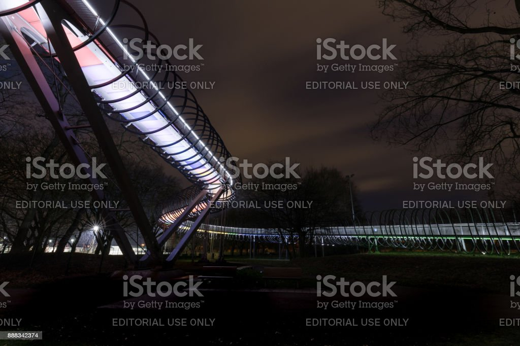 Oberhausen, NRW, Germany - February 21, 2017 At 7.00pm : Illuminated Bridge Slinky Springs To Fame stock photo