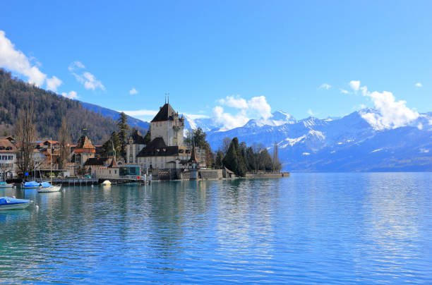 Oberhofen Castle from Lake Thun. Oberhofen town is located on the northern shore of Lake Thun. Switzerland, Europe. stock photo