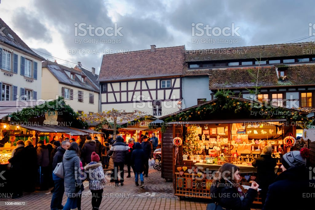 People enjoying the advent in the old town of Obernai, where every...