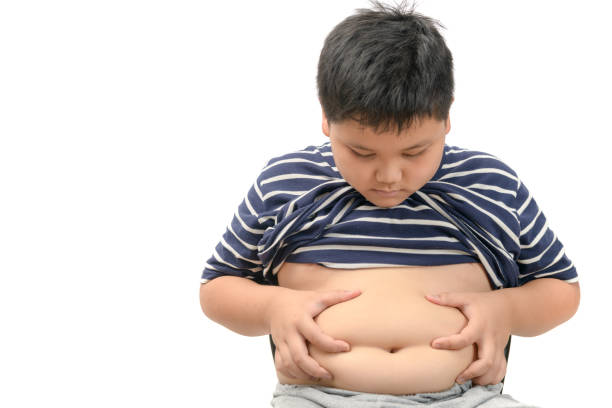 Obese fat boy overweight isolated on white stock photo