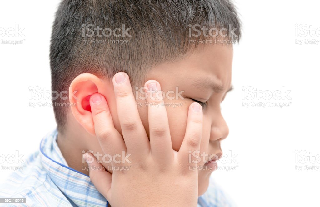 Obese fat boy touching his painful ear isolated stock photo