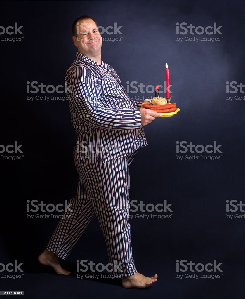 Obese man carries a dinner stock photo