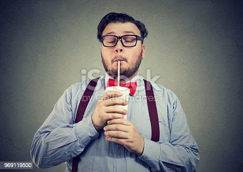 1067846662 istock photo Obese man enjoying sugar soda 969119500