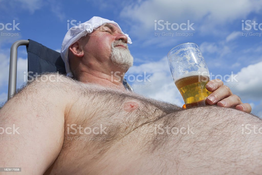 Obese Man With A Glass Of Beer stock photo