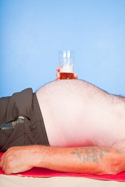 Obese Man With A Pint Of Beer stock photo