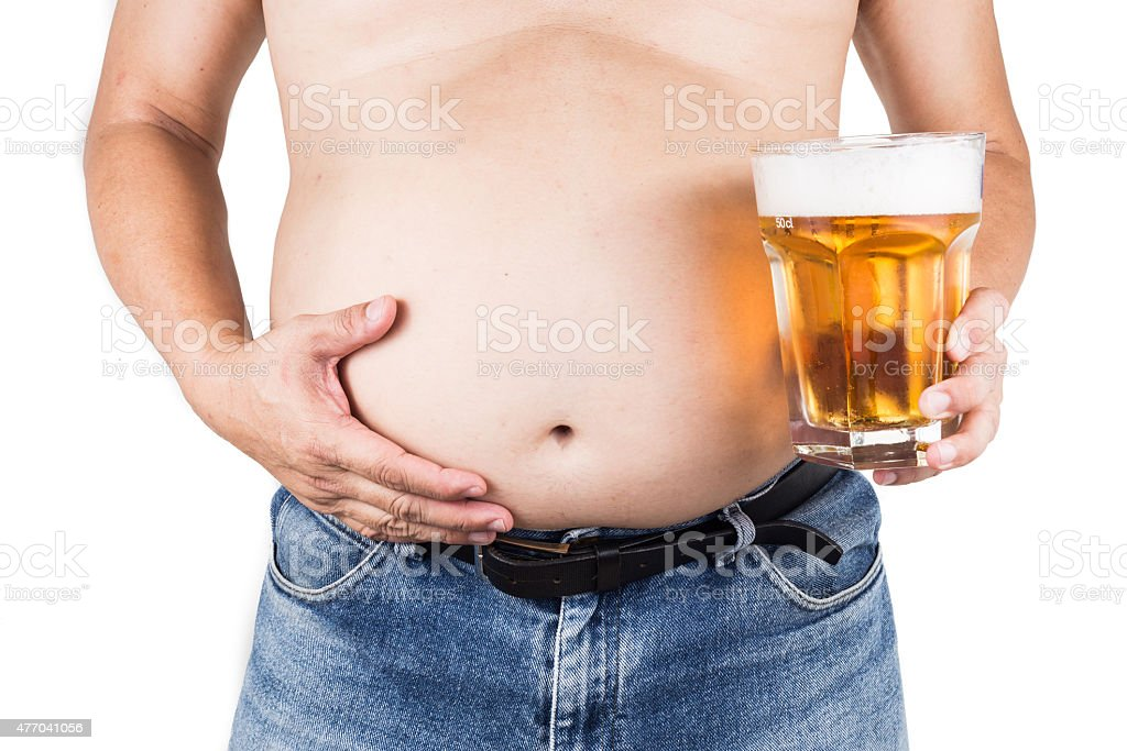 Obese man with big belly holding a glass of beer stock photo
