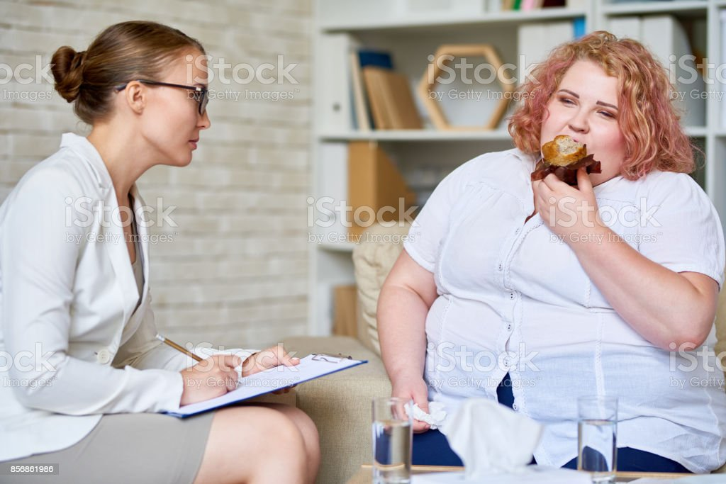 Obese Woman Consulting about   Eating Disorder stock photo