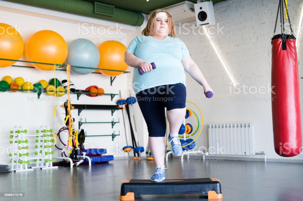 Obese Woman Doing Step Fitness stock photo
