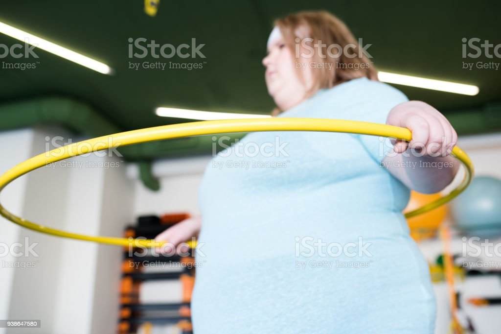 Obese Woman with Hula Hoop stock photo