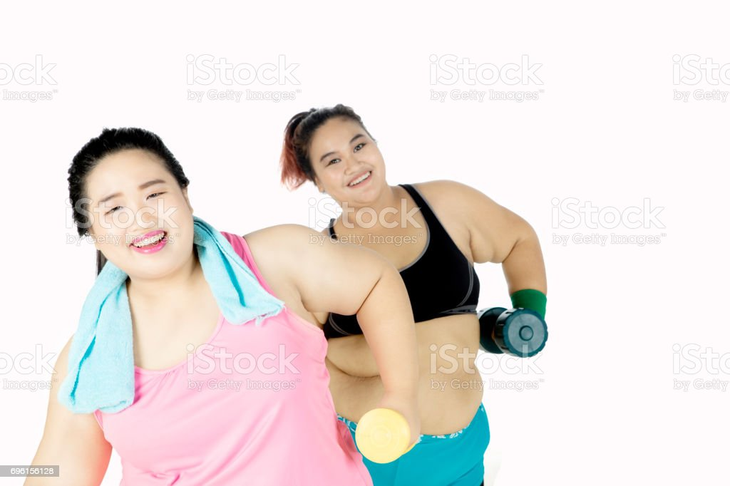 Obese Women Doing Workout With Dumbbell Stock Photo - Download Image