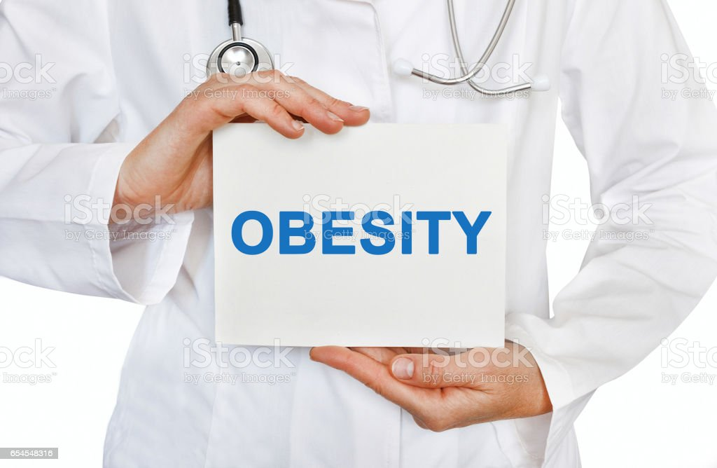 Obesity card in hands of Medical Doctor stock photo