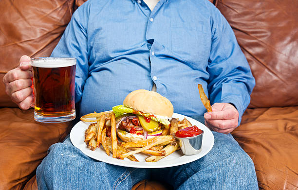 obesity is a major cause of diabetes - stomach sitting stock photos and pictures