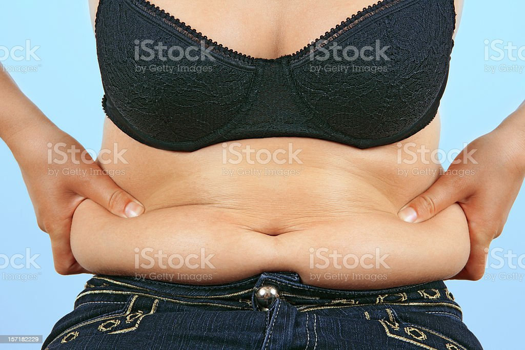 Obesity (overweight female belly) stock photo
