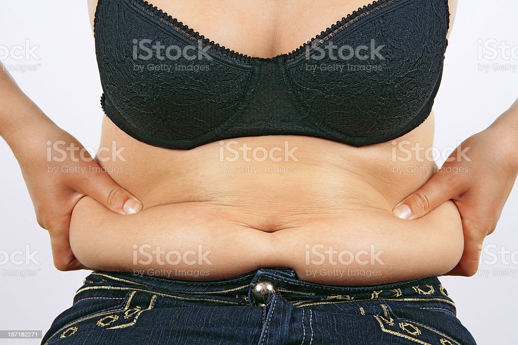 Obesity (overweight female belly) royalty-free stock photo