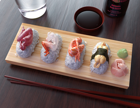 High resolution digital image depicting the concept of the sexual objectification and exploitation of women. Image shows a typical wooden platter of sushi, with four pieces of nigiri sushi; magaro (tuna), amaebi (sweet shrimp), sake (salmon) and tamago (omelet), as well as gari ginger, and wasabi. The top portion of each piece of sushi is a woman in despair, curled into some variation of a fetal position. This image could also effectively illustrate the cost of human suffering in the food supply chain, including issues pertaining to fair trade, as well issues relating to eating disorders, human rights, human trafficking, mental health and diet.