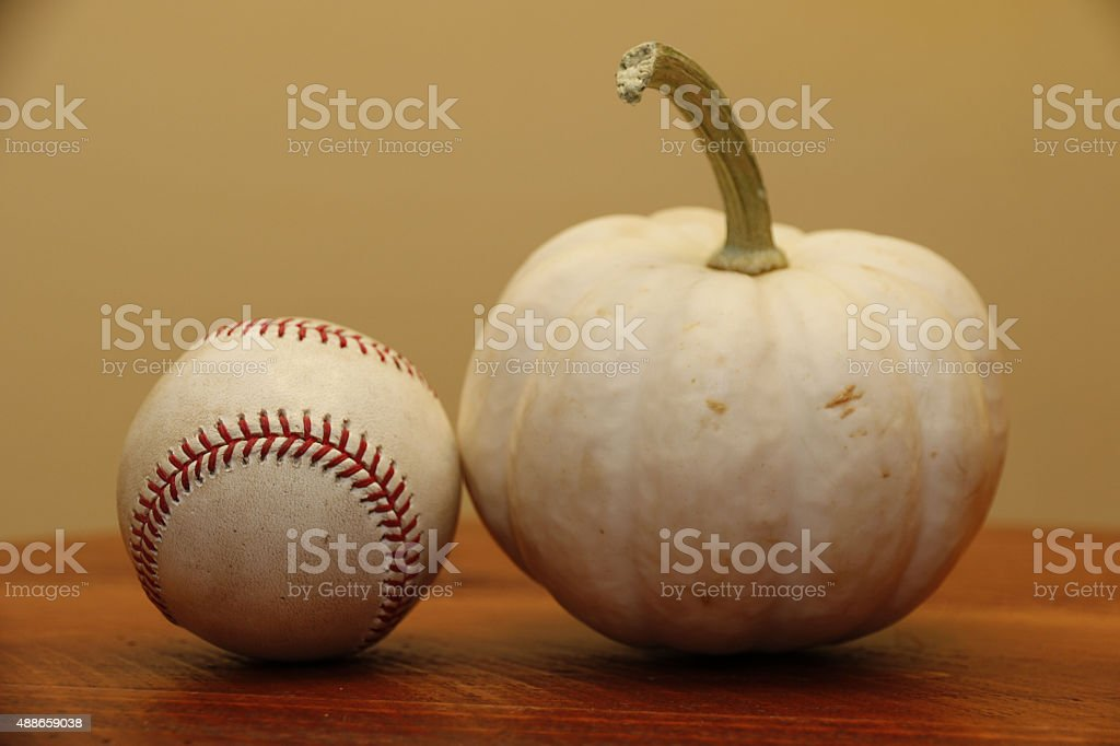 Objects: Baseball and pumpkin (white) stock photo