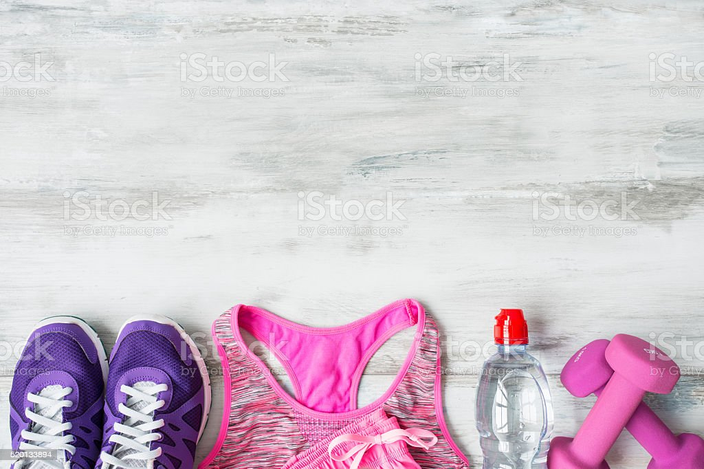 Objects for workout on wooden floor stock photo