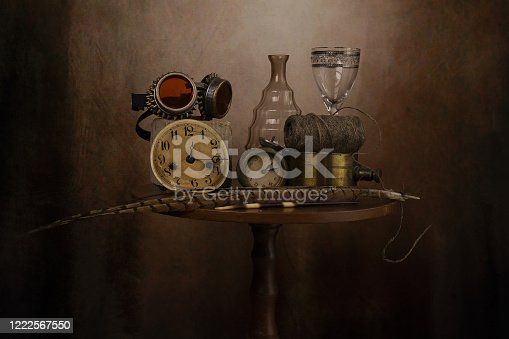Objects on the table is an ancient vase of flowers, fruit, wine glass.The photo was taken using a light effect brush.