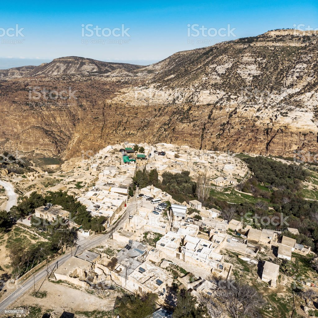 Oblique aerial view of Dana Village at the entrance of the biosphere reserve of the Dana Valley, north of Petra stock photo