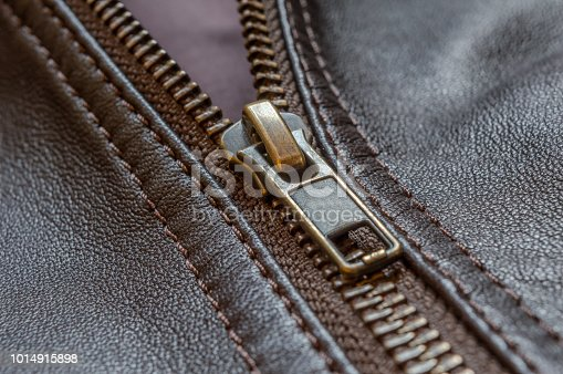 672414164istockphoto Oblique close up of the zip of an elegant brown leather jacket 1014915898