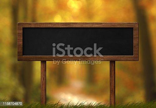istock Oblong blackboard sign autumn forest background 1158704870