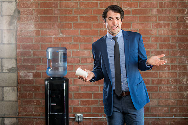 obnoxious nerdy businessman at water cooler - arrogance stock pictures, royalty-free photos & images