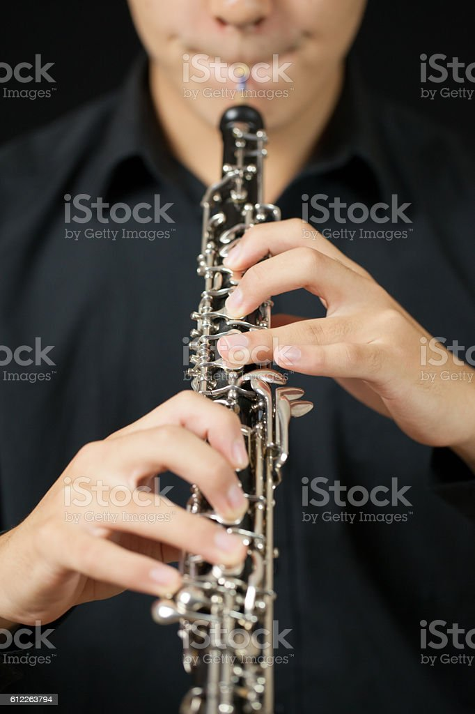 Oboe Player on Black stock photo