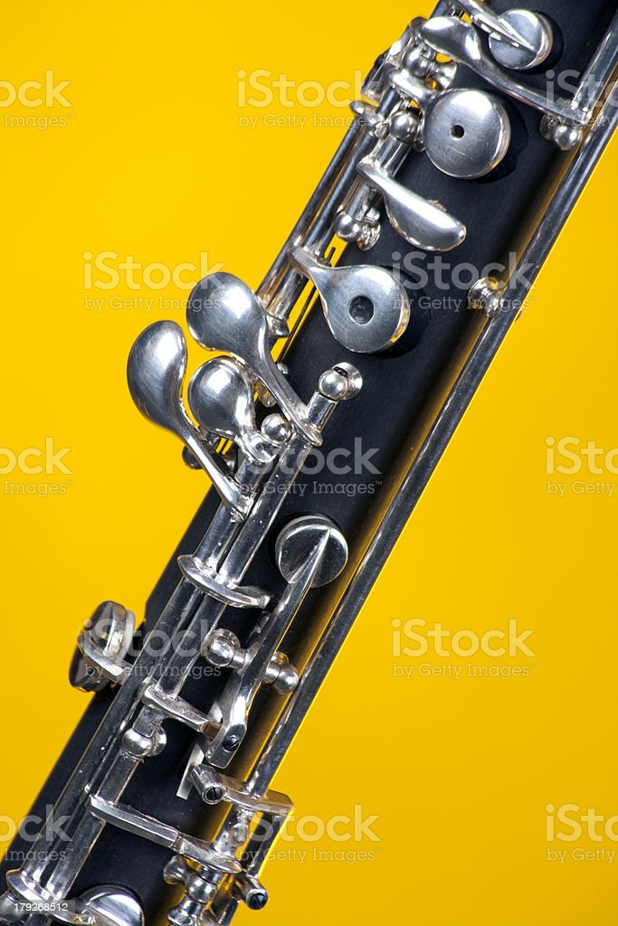 Oboe up Close On Yellow stock photo