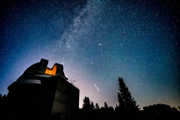 Observatory under milky way galaxy stock photo