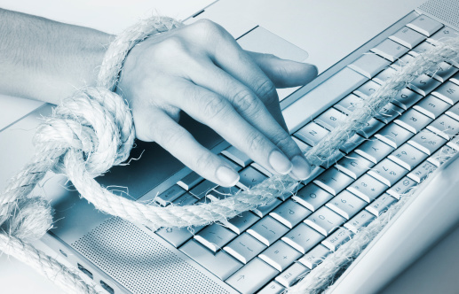 Obsessed And Tied Up To The Laptop Computer Internet Stock Photo - Download Image Now
