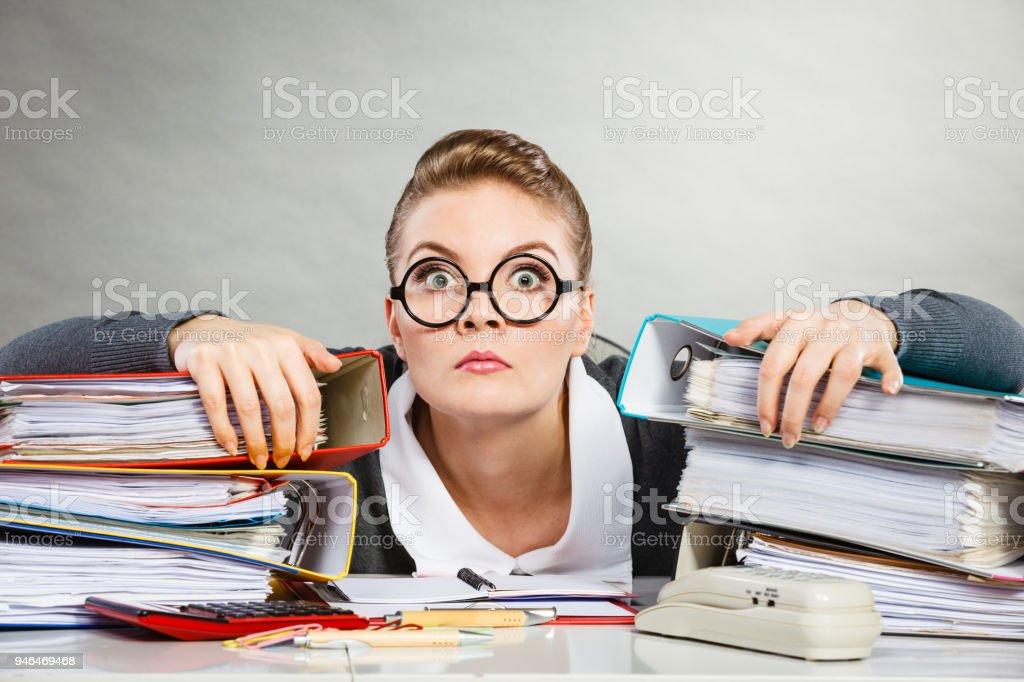 Obsessed female clerk at work. stock photo