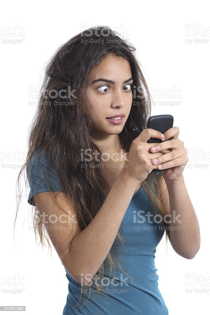 Obsessed teenager girl with the mobile phone technology stock photo