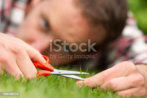 Man with shear on grass, ocd