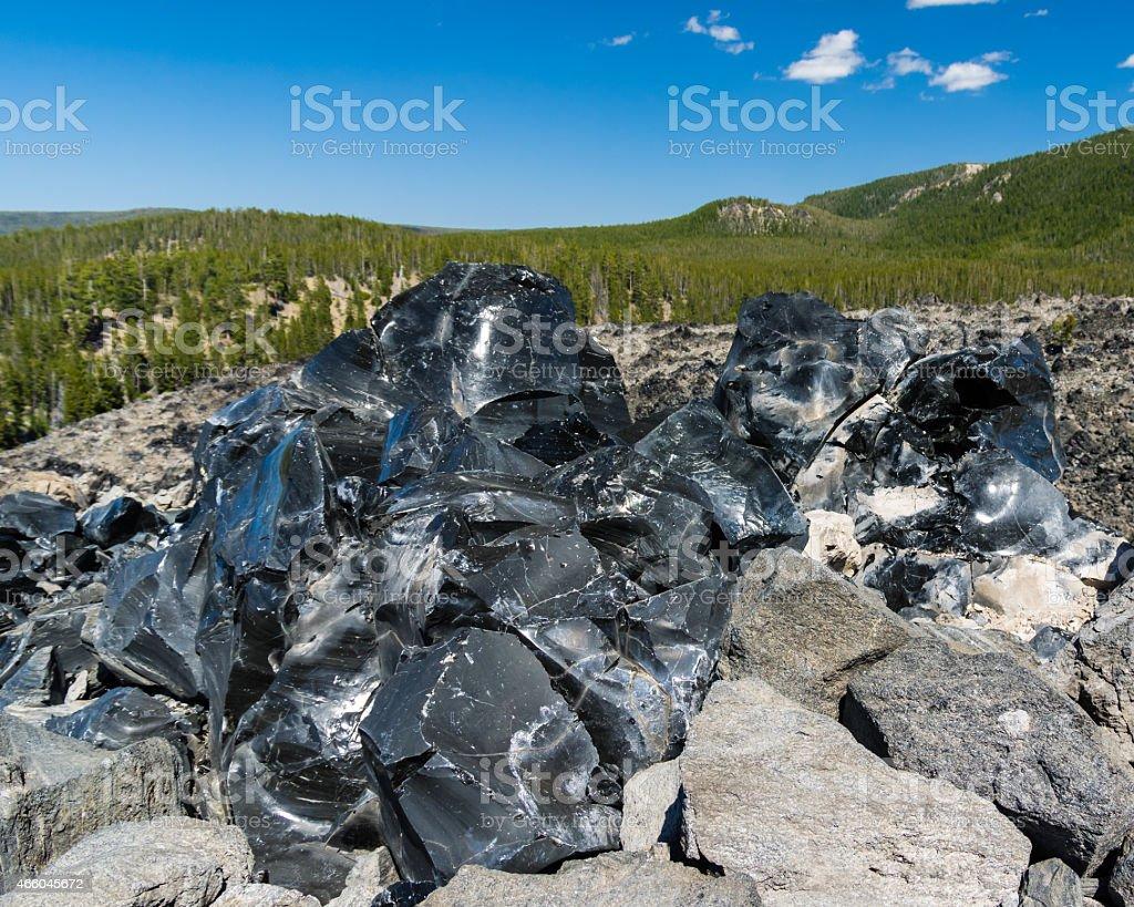 Obsidian black volcanic rock glass stock photo
